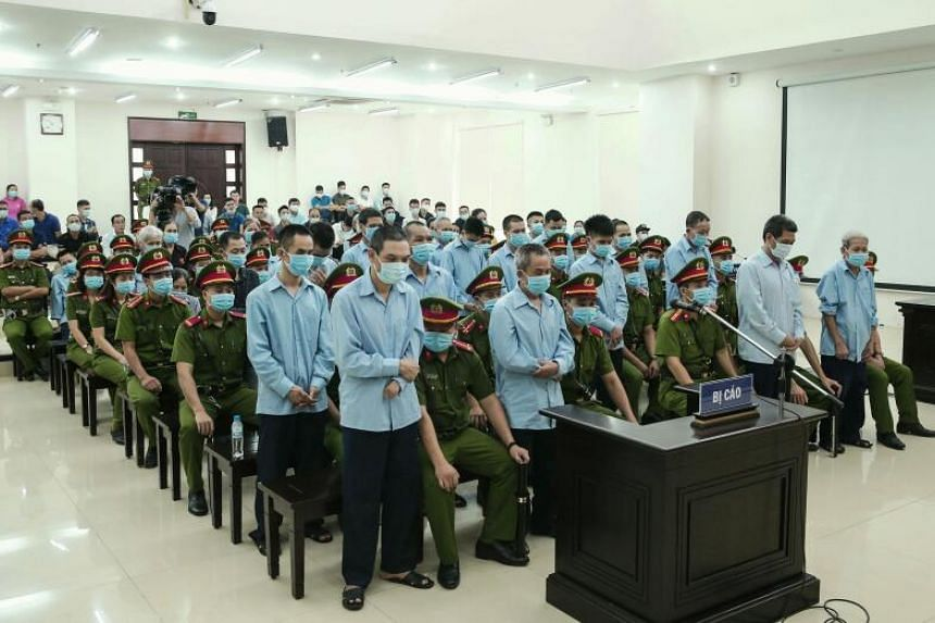 Defendants involved in a land dispute attending a court trial in Hanoi on Sept 14, 2020.