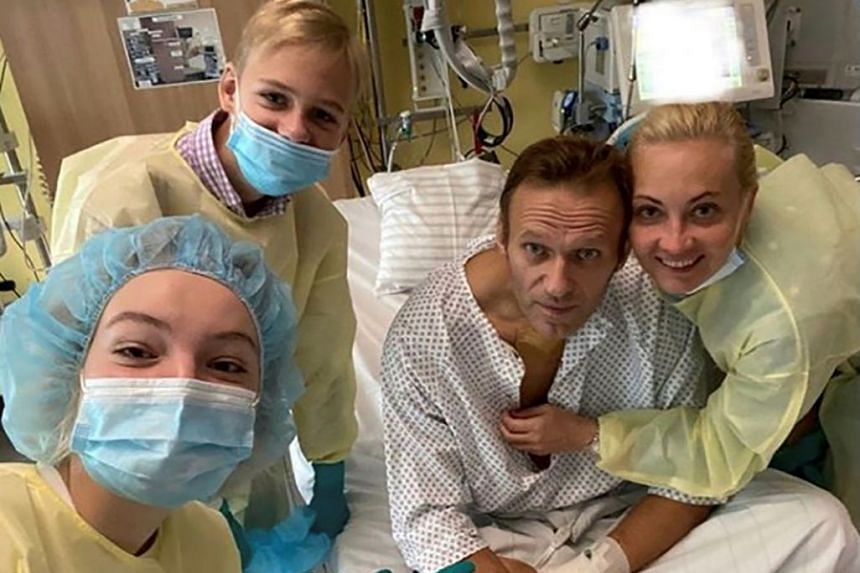 Navalny and his family members pose for a picture at Charite hospital in Berlin.