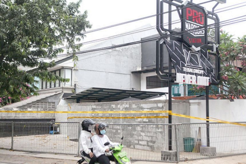 A police line surrounds a cafe which violated multiple warnings about implementing Covid-19 health protocols in South Jakarta on Sept 12, 2020.