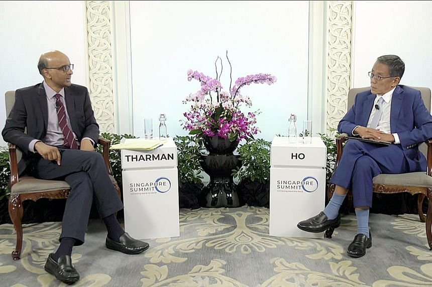 Senior Minister Tharman Shanmugaratnam with Banyan Tree Holdings executive chairman Ho Kwon Ping at the Singapore Summit.