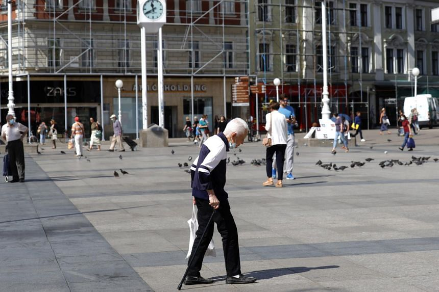 An elderly man crosses the Ban Jelacic square in Croatia on Sept 12, 2020.