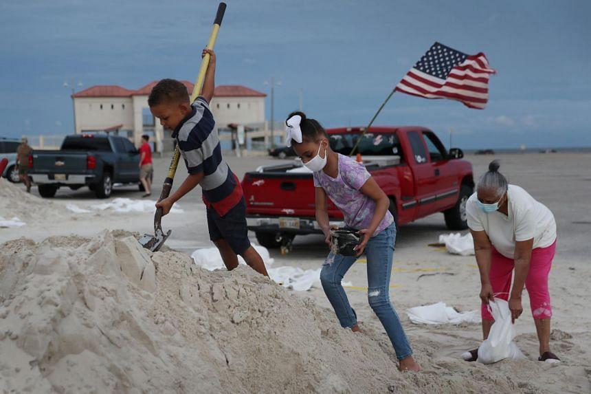 Residents fill sandbags on Sept 14, 2020, in Biloxi, Mississippi.
