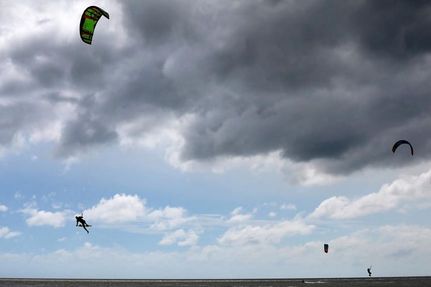 Kitesurfers seen as Hurricane Sally approaches in Bay St. Louis, Mississippi, on Sept 14, 2020.