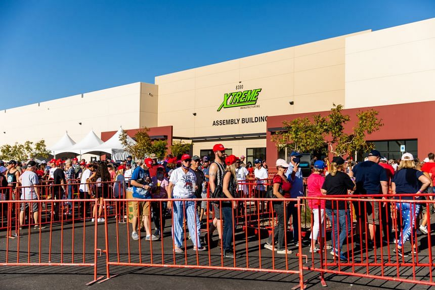 Attendees wait to enter US President Donald Trump's campaign rally at Xtreme Manufacturing's warehouse in Nevada on Sept 13, 2020.