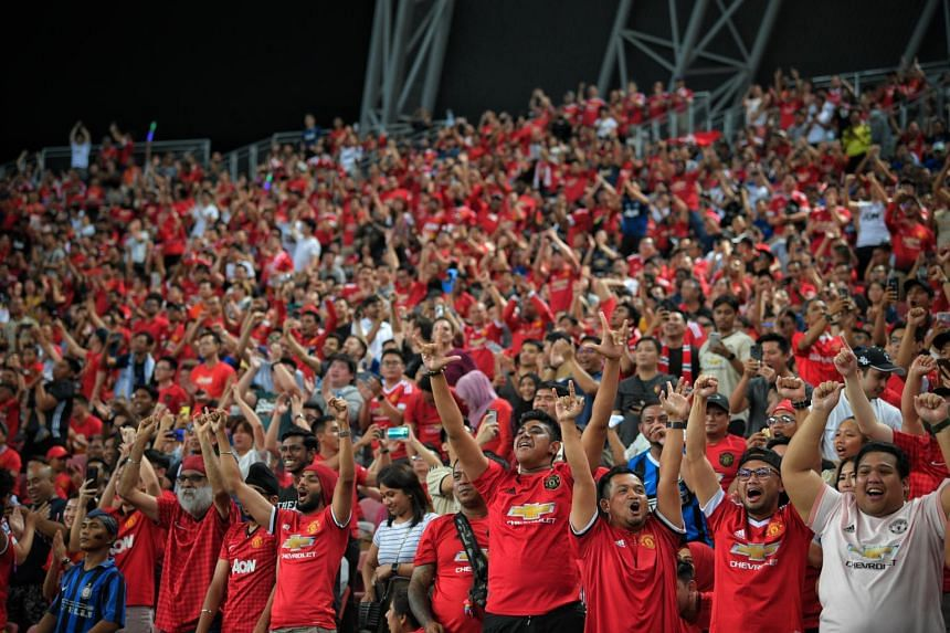 Football fans during the International Champions Cup match between Manchester United and Inter Milan, at the Singapore Sports Hub on July 20, 2019.