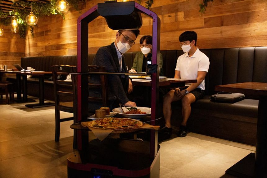 """Aglio Kim"" is a trolley-like robot which uses AI to deliver food to customers at a restaurant in Seoul."
