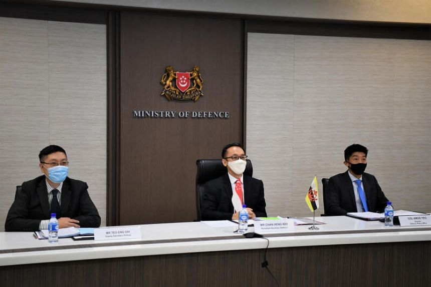 Singapore Permanent Secretary for Defence Chan Heng Kee (centre), flanked by Deputy Secretary  (Policy) Teo Eng Dih (left) and Policy Office Director Amos Yeo at the 8th Singapore-Brunei Defence Policy Dialogue on Sept 15, 2020.