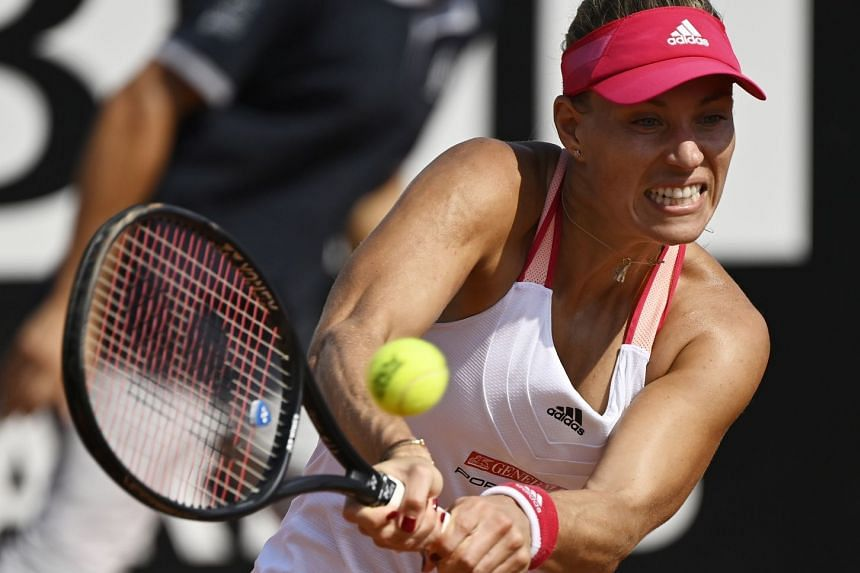 Kerber hits a backhand in her first-round match against Katerina Siniakova of the Czech Republic.