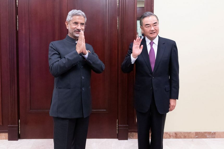 Chinese State Councilor and Foreign Minister Wang Yi (right) meets Indian Foreign Minister Subrahmanyam Jaishankar on the sidelines of the meeting on Sept 10, 2020.