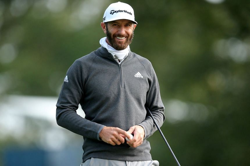 Johnson smiles on the eleventh green during a practice round for the 2020 US Open.
