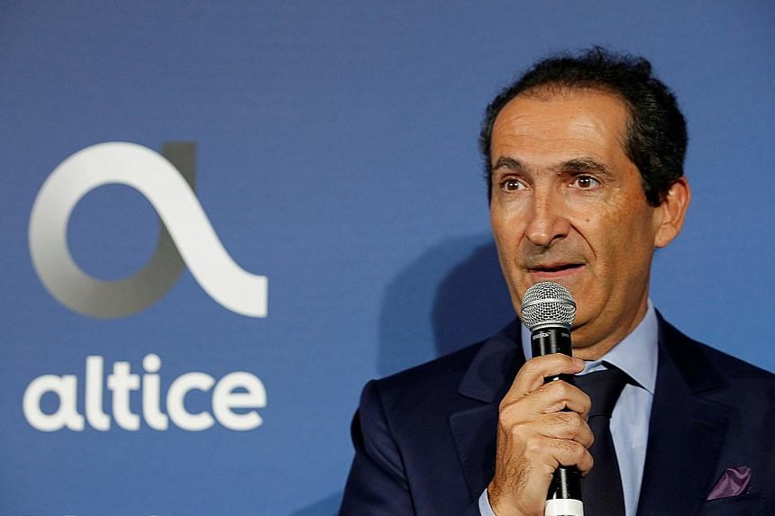 Top: SoftBank chairman Masayoshi Son is revisiting the idea of a management buyout of the Japanese conglomerate. Above: Media magnate Patrick Drahi is offering €2.5 billion (S$4 billion) to take Altice Europe private. PHOTOS: REUTERS