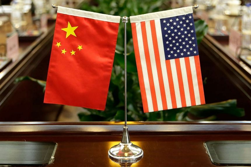 Flags of the China and the US at a ministry in Beijing in a 2017 photo.