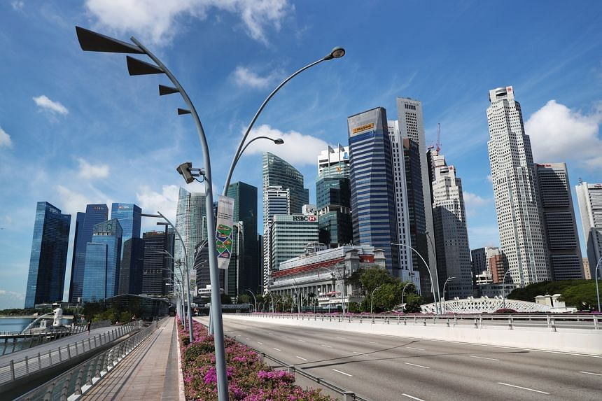 Empty roads leading towards the central business district in Singapore on April 8, 2020.