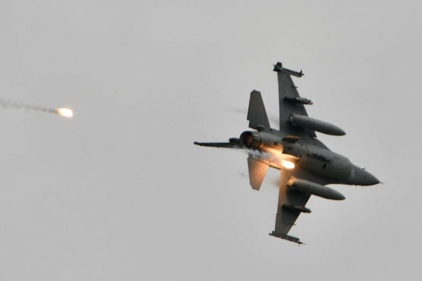 A US-made F-16V releases flares during the annual Han Kuang military drills in Taichung on July 16, 2020.
