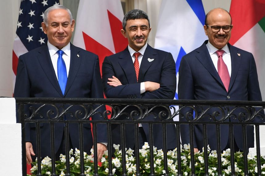 (From left) Israel's Benjamin Netanyahu, UAE's Abdullah bin Zayed Al-Nahyan and Bahrain's Abdullatif al-Zayani pose before they participate in the signing of the Abraham Accords.