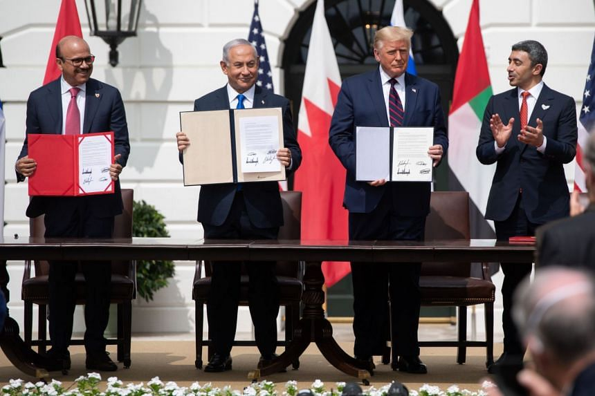 (From left) Bahrain Foreign Minister Abdullatif al-Zayani, Israeli Prime Minister Benjamin Netanyahu, US President Donald Trump and UAE Foreign Minister Abdullah bin Zayed Al-Nahyan participate in the signing of the Abraham Accords.