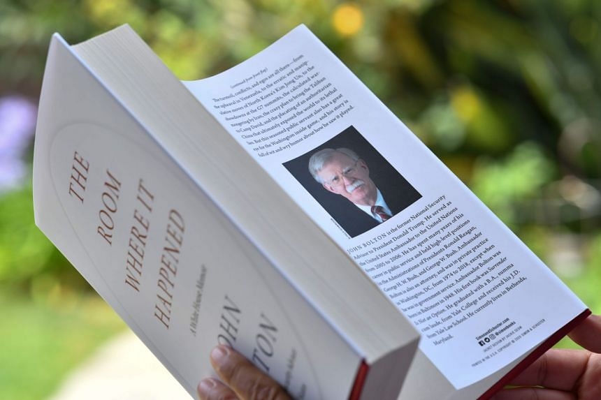 John Bolton is pictured on the dust jacket of a copy of his book on the day of its release in June 2020..
