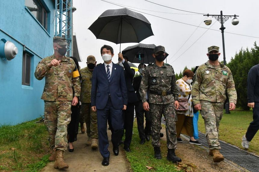 South Korean Unification Minister Lee In-young walks with military officers during a visit to the Demilitarised Zone on Sept 16, 2020.