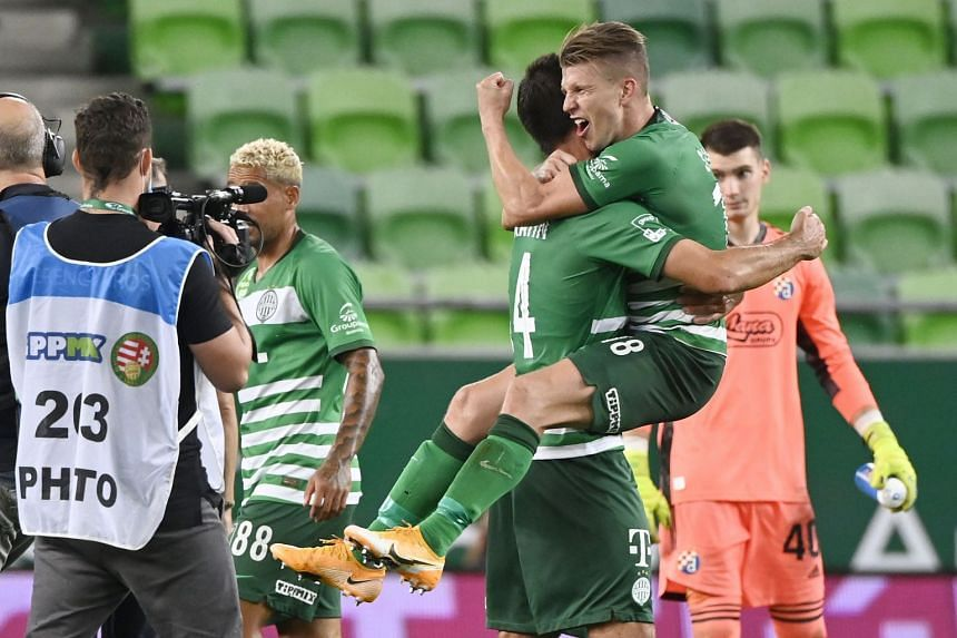 David Siger (right) and Ihor Kharatin of Ferencvaros celebrate the team's win.