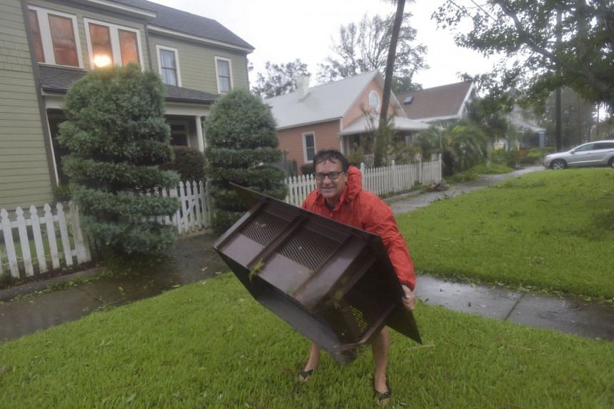 Don Boyd surveys storm damage from Hurricane Sally at his home in Pensacola, Florida.