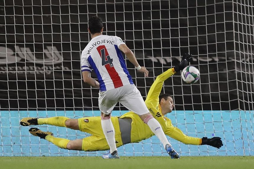 Goalkeeper Asmir Begovic saving Crystal Palace captain Luka Milivojevic's second spot kick in Bournemouth's 11-10 shoot-out win after the game ended 0-0 at full time on Tuesday. Bournemouth will advance to a third-round League Cup clash with holders