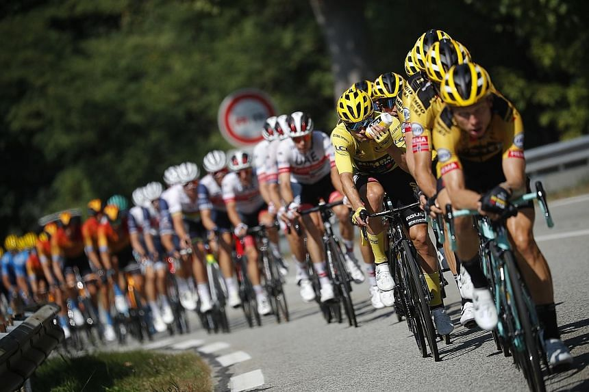 The peloton making its way up the slope during stage 17 of the Tour de France yesterday. Miguel Angel Lopez won the stage but overall leader Primoz Roglic managed to extend his advantage over fellow Slovenian Tadej Pogacar to 54sec. PHOTO: REUTERS