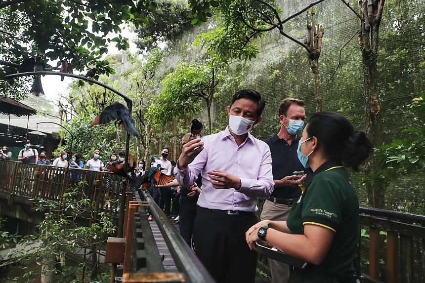 Trade and Industry Minister Chan Chun Sing, who unveiled details about the SingapoRediscovers Vouchers, on a visit to Jurong Bird Park yesterday with Mandai Park Holdings group chief executive Mike Barclay. Despite the pandemic-related setbacks, the