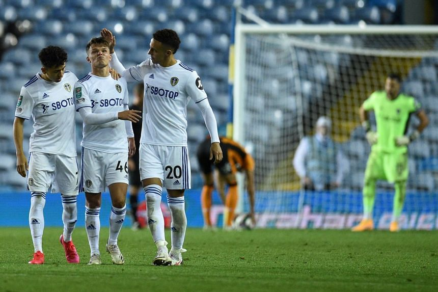 Leeds United's Jamie Shackleton (second left) reacts after failing to score during a penalty shootout.