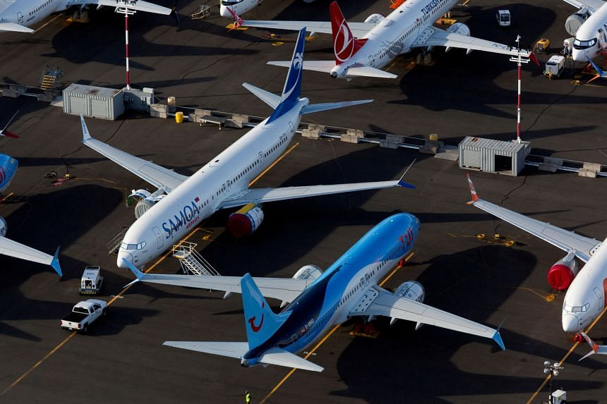 Boeing 737 Max aircraft at a parking lot at Boeing Field in Seattle, Washington, in June. The model has been grounded since March last year. PHOTO: REUTERS