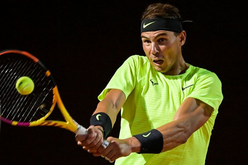 Nadal plays a backhand to Spain's Pablo Carreno Busta.