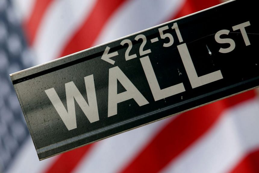 A street sign is seen in front of the New York Stock Exchange in New York.,