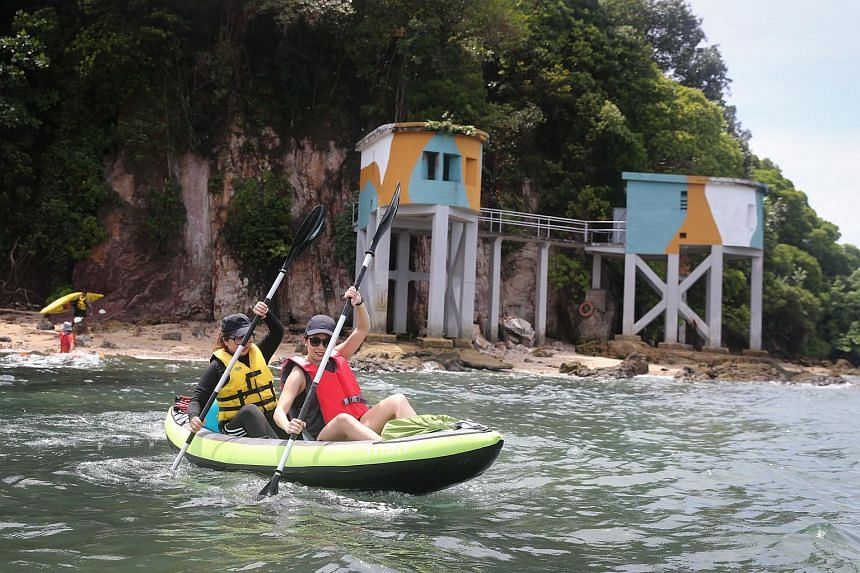 Journalist Clara Lock (right) and Ms Sheena Neo kayaking near Tanjong Rimau, which has several World War II gun turrets.