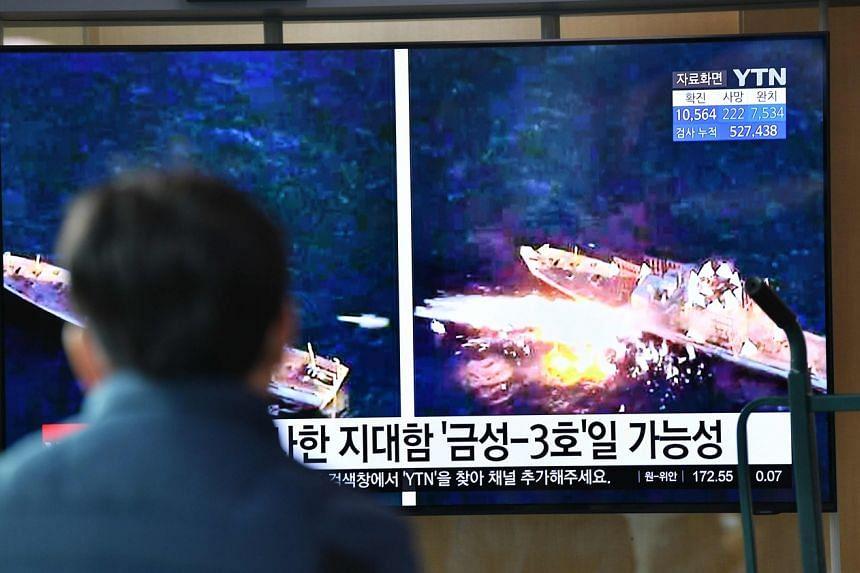 A man watches a news broadcast showing file footage of a North Korean missile test, in Seoul on April 14, 2020.