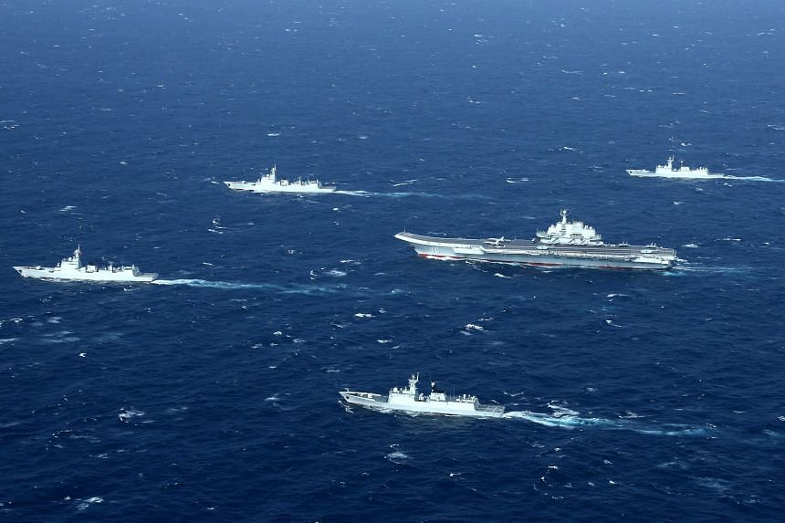 A photo taken on Jan 2, 2017, shows a Chinese Navy formation during military drills in the South China Sea.