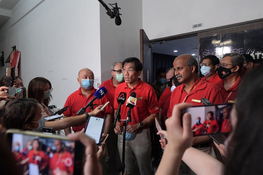 Singapore Democratic Party chief Chee Soon Juan and chairman Paul Tambyah speaking to the media at the party's headquarters in Ang Mo Kio on the night of the general election in July. The party yesterday presented its appeal in the apex court against