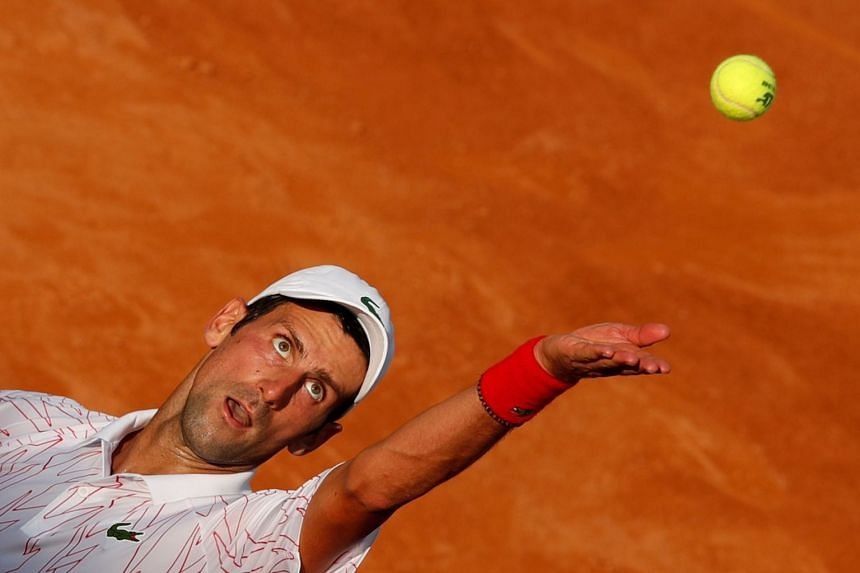 Nadal crashes out, Djokovic battles into Italian Open semi-finals