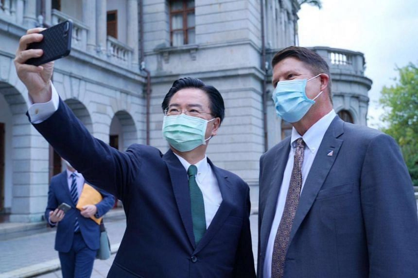 Taiwan Foreign Minister Joseph Wu (left) takes a selfie with US Undersecretary of State for Economic Affairs Keith Krach in Taipei, on Sept 18, 2020.