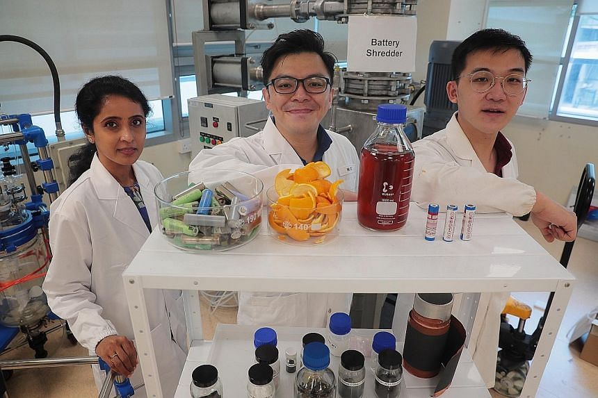From left: Professor Madhavi Srinivasan, Assistant Professor Dalton Tay and research assistant Kenny Wu Zhuoran are part of a team that developed a method of using fruit peel waste to extract precious metals from spent lithium-ion batteries.