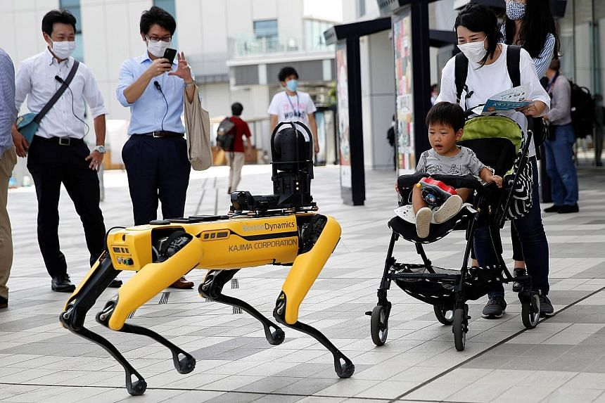 Boston Dynamics' robot Spot amusing passers-by during a demonstration at Tokyo Robot Collection in Japan yesterday. The Japanese government has made digital transformation its main policy plank this year, and Prime Minister Yoshihide Suga has pledged