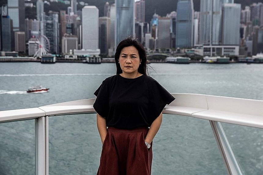 "Pro-democracy activist Carol Ng has received menacing calls from strangers and been bombarded with messages calling her a ""cockroach"" since her personal phone number was posted online."