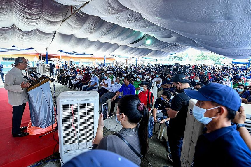 Malaysian Prime Minister Muhyiddin Yassin delivering a speech during an event yesterday in Kota Belud, Sabah. His Perikatan Nasional coalition, with its allies Barisan Nasional and Parti Bersatu Sabah, hopes to replace Parti Warisan Sabah as the stat