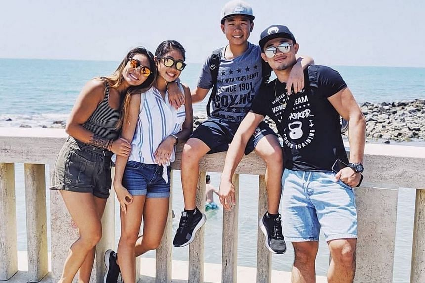 Victoria Lee (second from left) follows in the footsteps of older siblings Angela and Christian (right) as she joins MMA promotion One Championship. Younger brother Adrian is also an MMA practitioner.