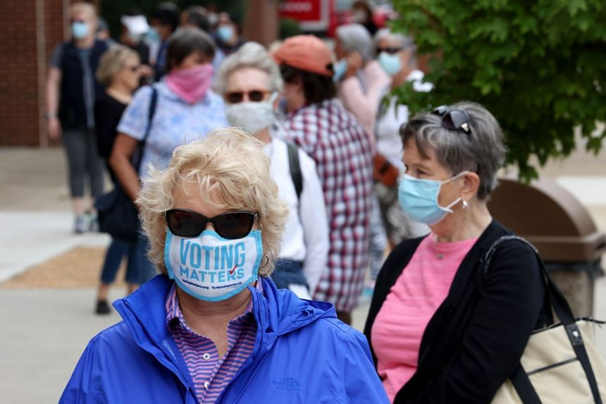 Voters wait to cast their ballots in Henrico, Virginia, Sept 18, 2020.