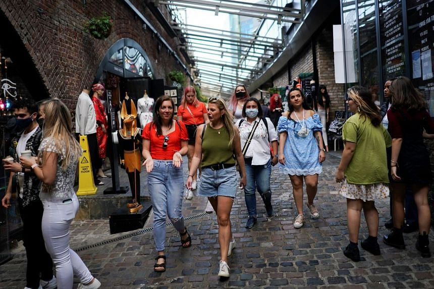 People visit the Stables Market in Camden, London, Sept 19, 2020.