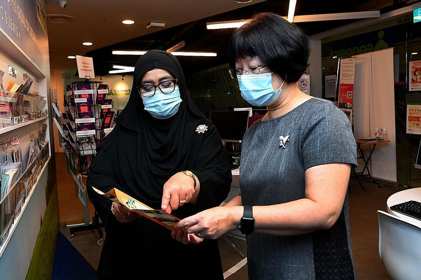Senior career coach Judy Yap (right in photo, with Ms Noraini Misrom) helped boost Ms Noraini's resume and also kept a lookout for a suitable position for her.
