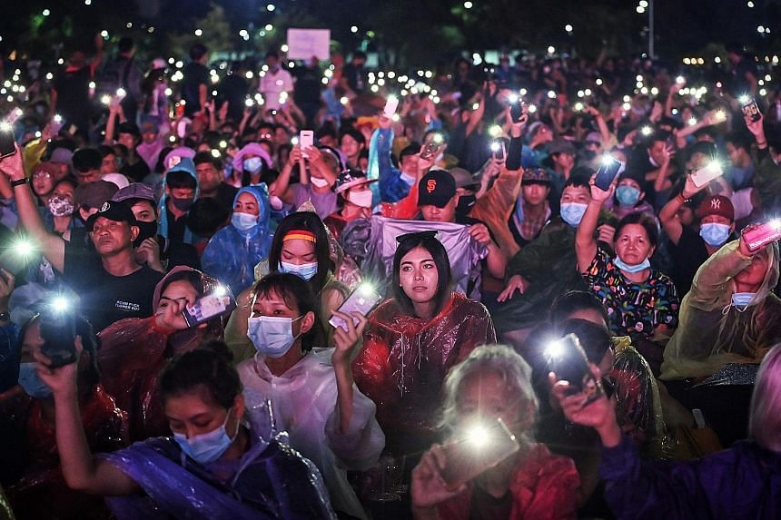 Protesters holding their mobile phones aloft, as they took part in a pro-democracy rally in Bangkok yesterday. They are demanding reforms to the powerful monarchy, removal of the government and fresh polls. PHOTOS: AGENCE FRANCE-PRESSE
