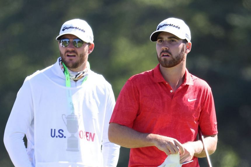 Wolff (right) prepares to hit off the first tee with caddie Nick Heinen during the third round.