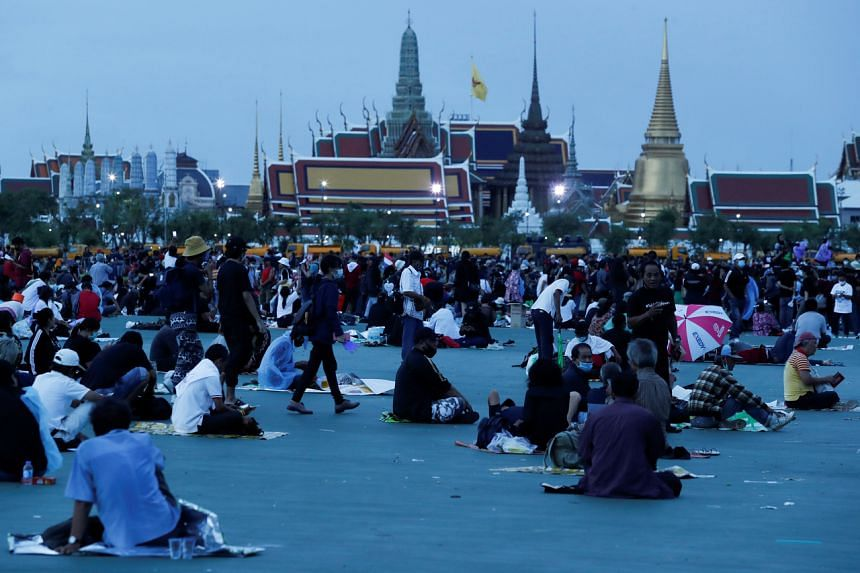 Pro-democracy protesters wake up in front of the Grand Palace after camping during a mass rally in Bangkok on Sept 20, 2020.