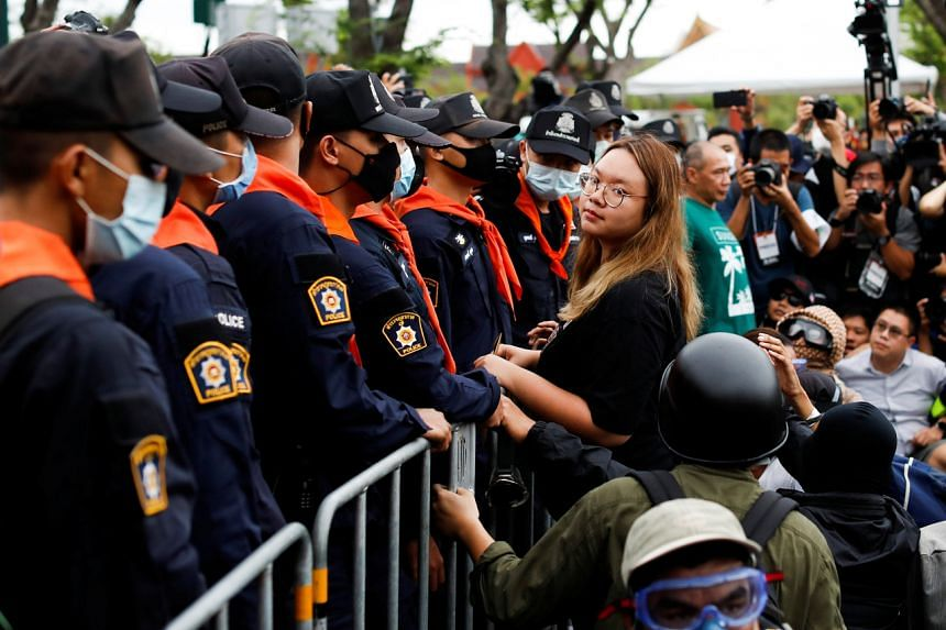 Police officers stand guard as pro-democracy protesters take part in a mass rally in Bangkok on Sept 20, 2020.