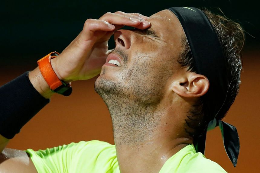 Nadal reacts after losing a point to Argentina's Diego Schwartzman.